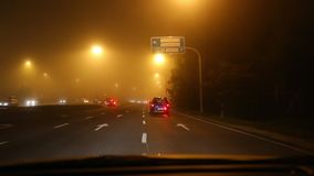 Driving in fog stock video footage
