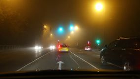 Driving in fog stock footage