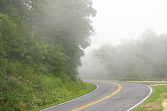 Driving on a foggy road Stock Photo
