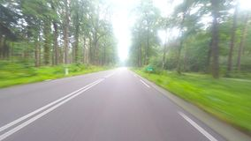 Driving footage on a European country road. With sunshine rays stock video
