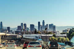 Driving on the freeway to Los Angeles Downtown, California. Panoramic view on the LA skyline from the city interstate on 09.08.2015 Royalty Free Stock Image