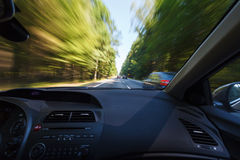 Driving during good weather conditions, overtaking. Overtaking during good weather conditions, overtaking - image with natural motion blur, view from passenger Stock Images