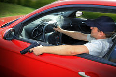Driving with gun Stock Photos