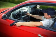 Driving with gun stock photos