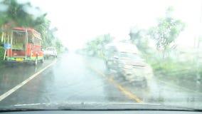 Driving in hard rain stock video