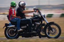 Driving a harley with the child Stock Photos
