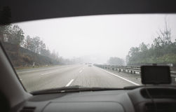 Driving in the haze Royalty Free Stock Photos