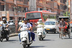 Driving in heatwave in India. People are forced to work and go to their work places in extreme dry heat wave hitting most states in India, endangering health and Royalty Free Stock Photo