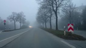 Driving heavy dense fog in city road. stock video