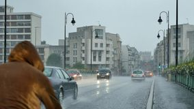 Driving, heavy rain, outskirts of paris, France stock video footage