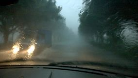 Driving in heavy raining in evening Stock Images