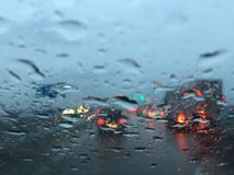 Driving in the heavy traffic because of the rain and road repair. Difficult weather conditions on city road. Driving in the heavy traffic because of the rain Stock Photography