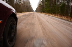Driving at high speed down a country road Stock Photos