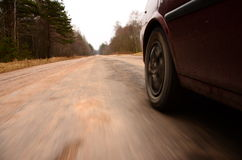 Driving at high speed down a country road Royalty Free Stock Image