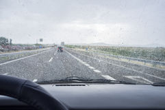 Driving on a highway in the rain. View from the inside of the car Stock Photography