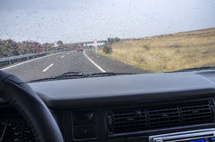 Driving on a highway in the rain. View from the inside of the car Stock Images