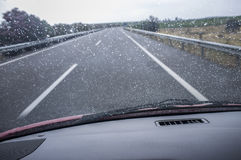 Driving on a highway in the rain. View from the inside of the car Royalty Free Stock Photography