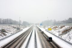 Driving on the highway A9 in a severe snowstorm in Netherlands. Driving on the highway A9 near Amsterdam in a severe snowstorm in winter in the Netherlands Royalty Free Stock Photos