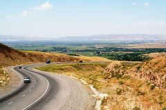 Driving on highway slope Royalty Free Stock Photo