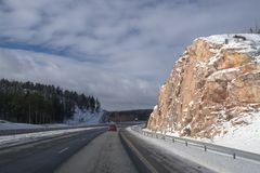 Driving on the highway after snow in winter Royalty Free Stock Image