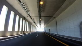 Driving on the Highway, Tunnel, Front View. In camera Stabilizer, No post editing, 4k video 3840X2160 stock footage
