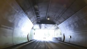 Driving on highway from tunnel to alpine road. Inside the car. Driving on European highway from tunnel to beautiful alpine road with picturesque view on the stock footage