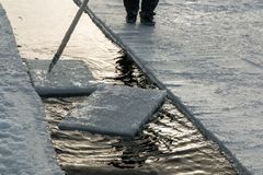 Driving ice cubes with pike pole Stock Images