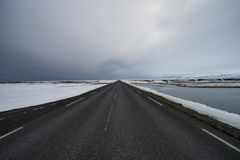 Driving through iceland with empty highway stock photos