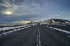 Driving through iceland with empty highway royalty free stock photography