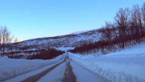 Driving on an icy road in Northern Norway during winter stock video footage