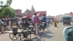 Driving in India through chaotic traffic, Jaipur stock footage