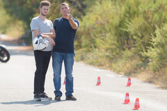 Driving instructor explains man exercise in motordrome Stock Images