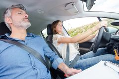 Driving instructor with female student. Drive royalty free stock images