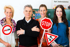 Driving instructor with his class Stock Photography