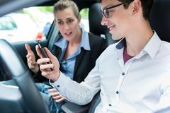 Driving instructor with student in car Stock Photos