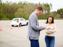 Driving instructor and woman student