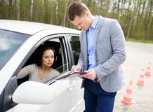 Driving instructor and woman student stock photography