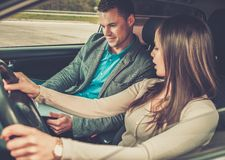 Driving instructor and woman student Stock Photo