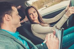 Driving instructor and woman student Royalty Free Stock Photography