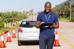 Driving instructor writing Stock Photos
