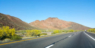 Driving on Interstate-10. Buttes, hills and low rise mountains along Interstate-10 east of city of Quartzsite.in Arizona desert covered with drought and extreme Royalty Free Stock Photography
