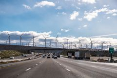 Driving on the interstate towards Palm Springs; Wind turbines installed at the entrance to Coachella Valley; Los Angeles county;. Riverside county; south royalty free stock photo
