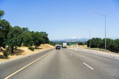 Driving on the interstate towards Redding, California. Driving on the interstate towards Redding; Mt Shasta covered in snow visible in the background; Northern royalty free stock photo