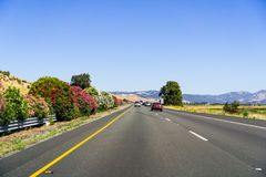 Driving on the interstate towards Redding, Northern California. Beautiful blooming azalea shrubs on the left Stock Photos