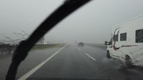 Driving on Italian highway with heavy rain. Driving shot, driver point of view stock footage