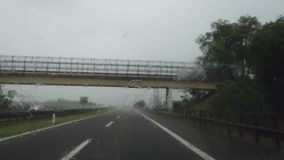 Driving on Italian highway with heavy rain. Driving shot, driver point of view. Summer time stock video