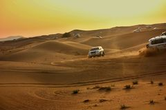 Driving on jeeps on the desert stock photography