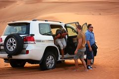 Driving on jeeps on the desert Royalty Free Stock Photo