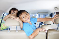 Driving with Kids. Asian children ready for a road trip posing in car Stock Photos