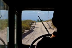 Driving a land rover on a dirt road between patagonia and cuyo argentine region stock image